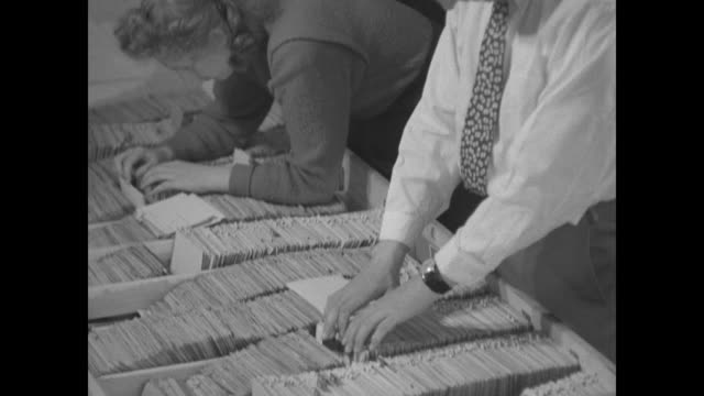 rainer hildebrandt and woman standing next to him going through cards in files that identify people imprisoned by communists / cu hildebrandt's hands... - filing cabinet stock videos & royalty-free footage
