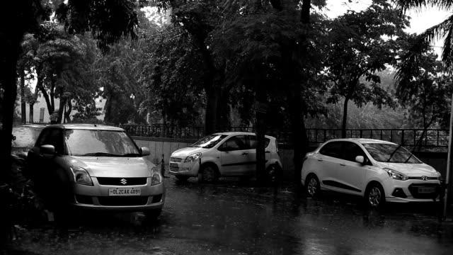rainfall in city street - high street stock videos & royalty-free footage