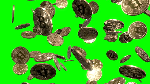 raining bitcoins on green - coin stock videos and b-roll footage