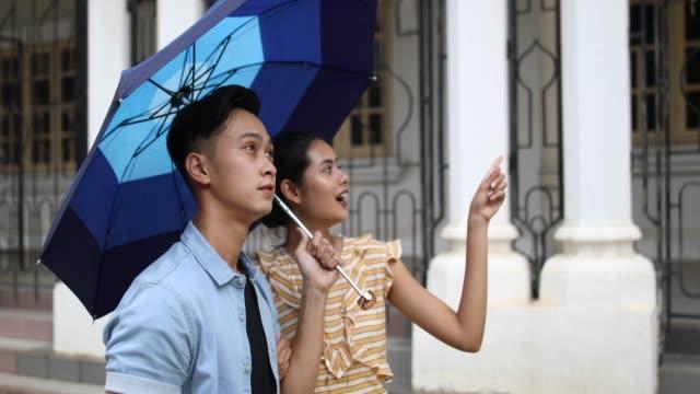 raining in kuala lumpur - sultan abdul samad building stock videos & royalty-free footage