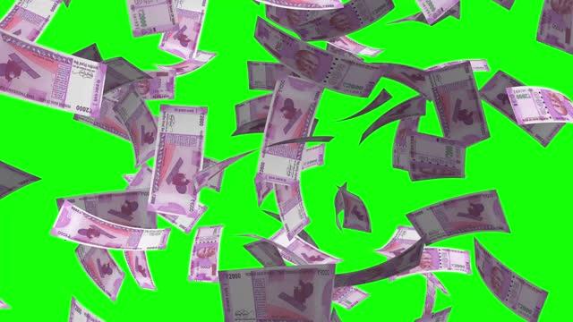 vídeos de stock e filmes b-roll de raining money stock video 2000 rupee india new currency over green screen chroma key background - ano 2000