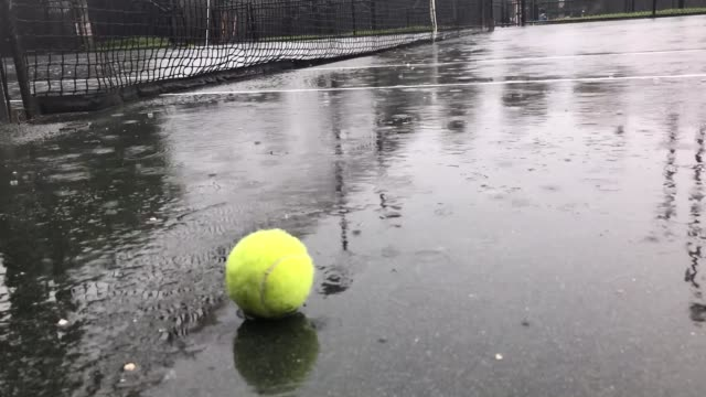 raining on tennis court - wet stock videos & royalty-free footage