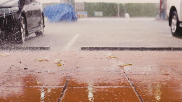 raining on the street - volume fluid capacity stock videos & royalty-free footage