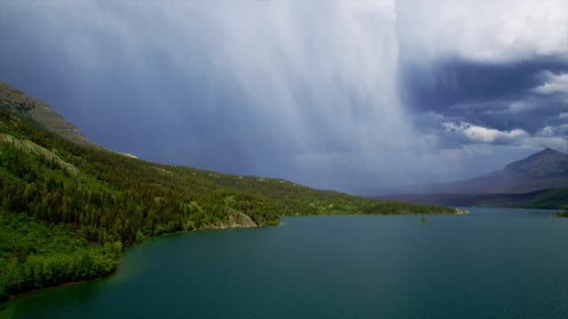 A rainstorm drifts behind St. Mary Lake in Glacier National Park.