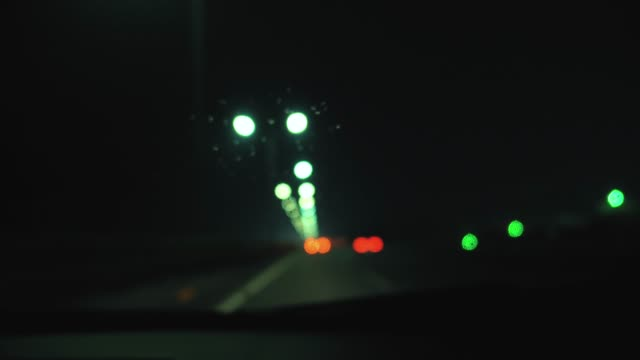 rainstorm in highway - rack focus stock videos & royalty-free footage
