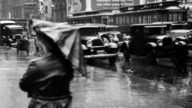 rainstorm on city streets, cars driving on streets, person holding umbrella / rain water washing along gutter in street / flooded rural street, car... - 1933 stock-videos und b-roll-filmmaterial