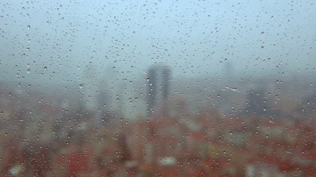 rainy city - rain drops on the window - city in background - flowing stream stock videos & royalty-free footage