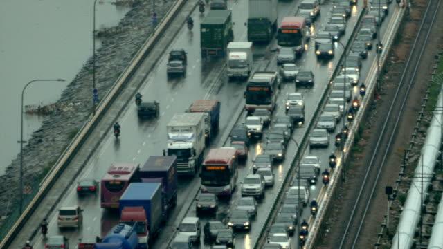 a rainy day at the singapore causeway bridge - johor stock videos & royalty-free footage