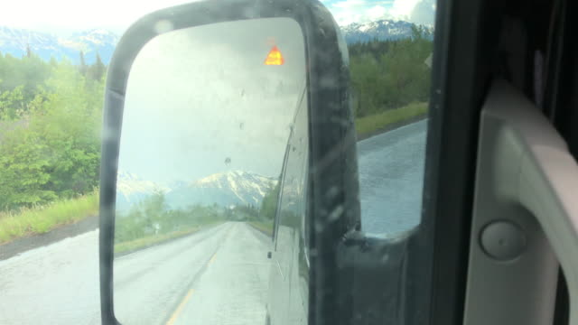 rainy day driving, side rear mirror showing the triangle shape blind spot warning sign, british columbia, canada - warning sign stock videos & royalty-free footage