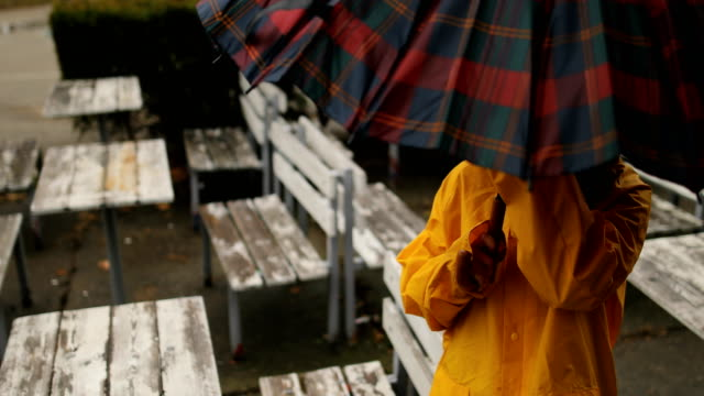 rainy day in the city park.opening umbrella - umbrella stock videos & royalty-free footage