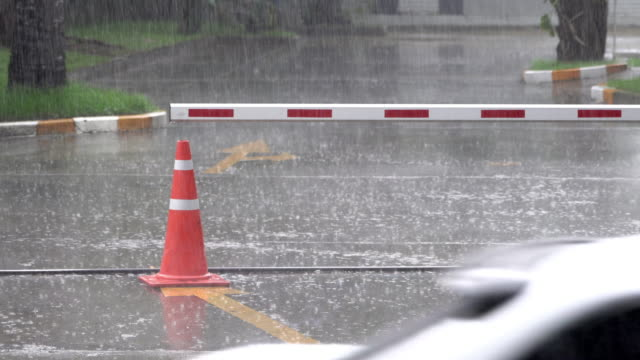 rainy day with traffic barrier and orange cone and arrow direction - traffic cone stock videos & royalty-free footage