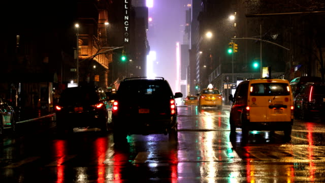 rainy manhattan nights - city street sign stock videos and b-roll footage