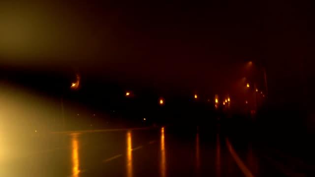 Rainy Night Drive with Yellow Highway Lights