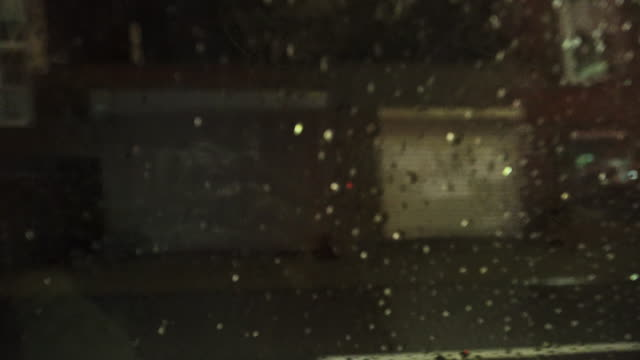 pov, rainy night in nyc taxi - taxi stock videos & royalty-free footage