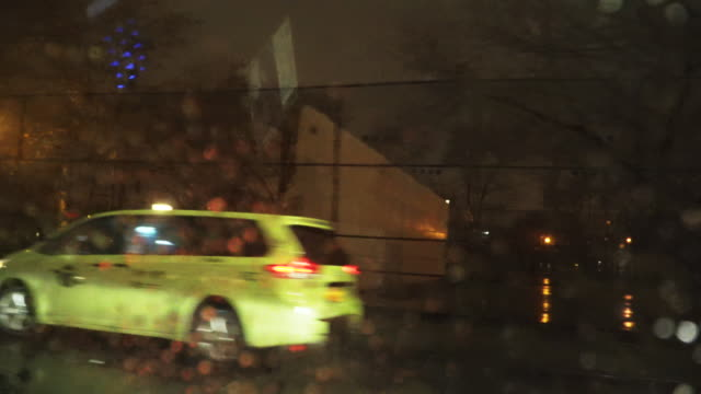 rainy night in nyc taxi, pov - taxi stock videos & royalty-free footage