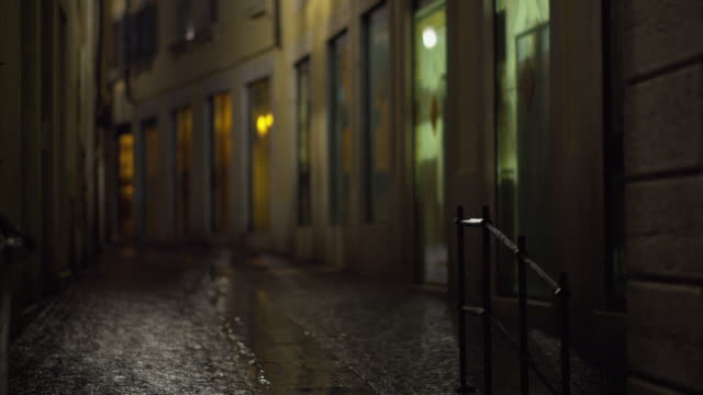 rainy night in verona on an empty road. - alley stock videos & royalty-free footage