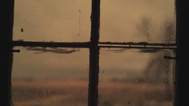 cu rainy old window, iowa, usa - a forma di croce video stock e b–roll