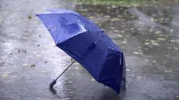 4K Rainy Season with Blue Umbrella on the floor