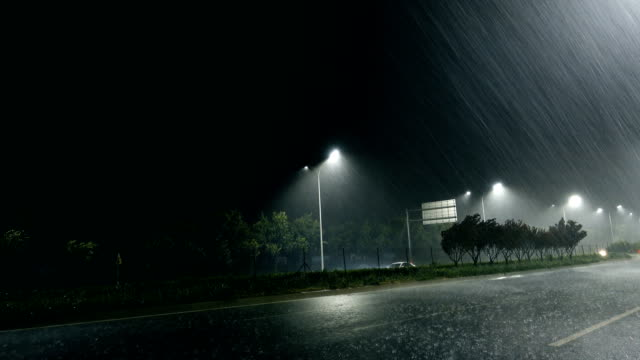 rainy street at night - pole stock videos & royalty-free footage