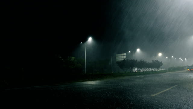 rainy street at night - shower stock videos & royalty-free footage
