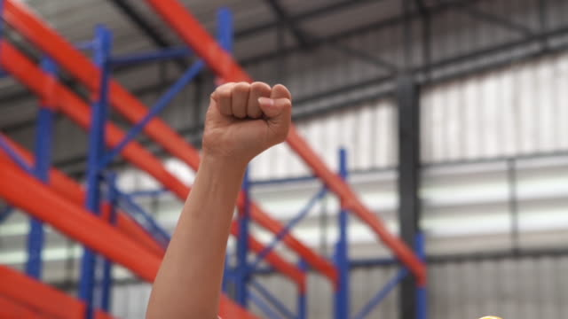 raise one's hand for cheering and success concept - fist stock videos & royalty-free footage