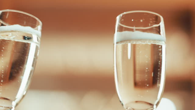 raise your glasses, we've got good news to share - celebratory toast stock videos & royalty-free footage