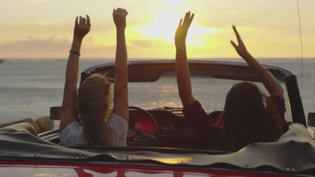 vídeos de stock e filmes b-roll de raise your hands for freedom - convertible