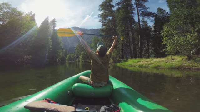 pov: raised arms while rafting in merced river of yosemite - arms raised stock videos & royalty-free footage