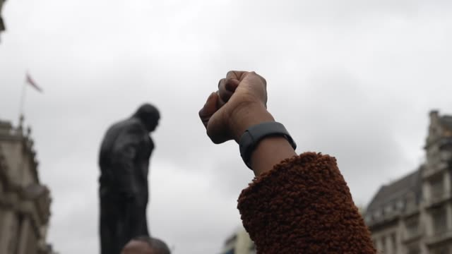raised black fist infant of winston churchill statue end sars protester in london due to nigerian police opened fire on protestors in lagos yesterday... - form of communication stock videos & royalty-free footage