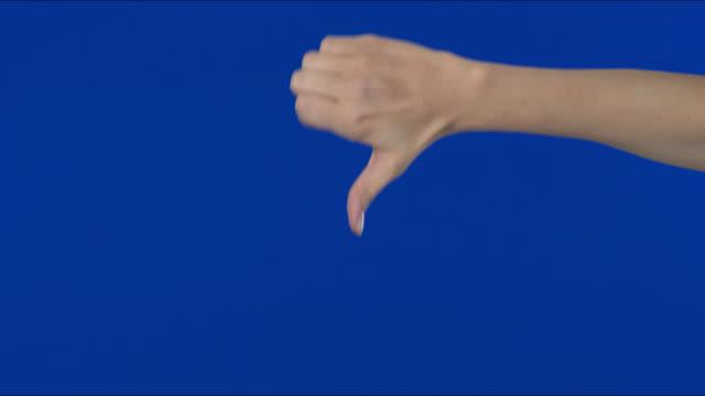 raised hand, gesturing, hand sign - refusal, displeasure, finger down. - fist stock videos & royalty-free footage