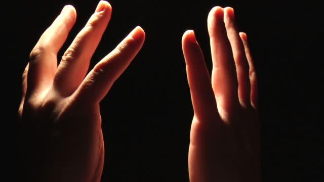 raised hand in praise and thankfullness