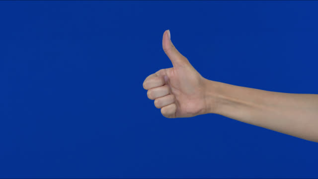 raised her hand, gesturing with success, showing it with her finger. - fist stock videos & royalty-free footage