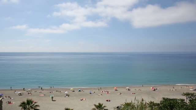 raised view of beach activity and tranquil sea - 2016 stock videos and b-roll footage