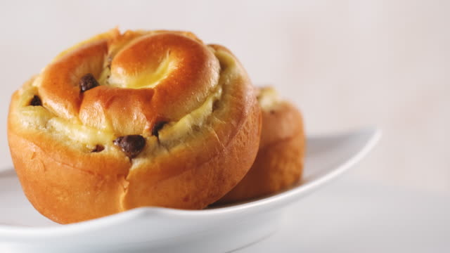 raisin - chocolate brioche buns - sliding shot - raisin stock videos & royalty-free footage