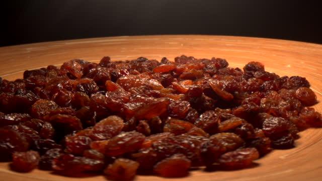 raisin heap on lazy susan - raisin stock videos & royalty-free footage
