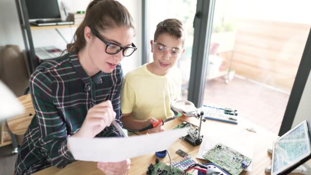 raising a future scientist - fuel and power generation stock-videos und b-roll-filmmaterial