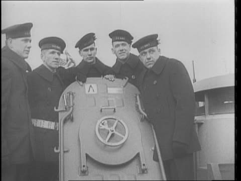 raising flag on us navy cruiser being launched / navy crew aboard named juneau / two sets of brothers featured from the crew / twin destroyers are... - juneau stock videos and b-roll footage