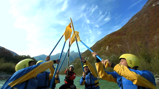 hd slow motion: raising oars up while rafting - rafting stock videos and b-roll footage