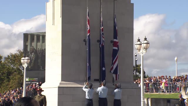 raising of new zealand, australian and union jack flags during anzac day service at auckland war memorial museum, new zealand. - anzac day stock videos & royalty-free footage