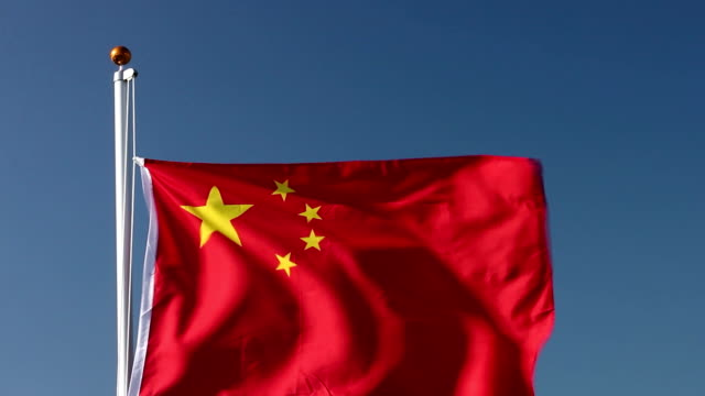 raising the chinese flag - chinese flag stock videos and b-roll footage
