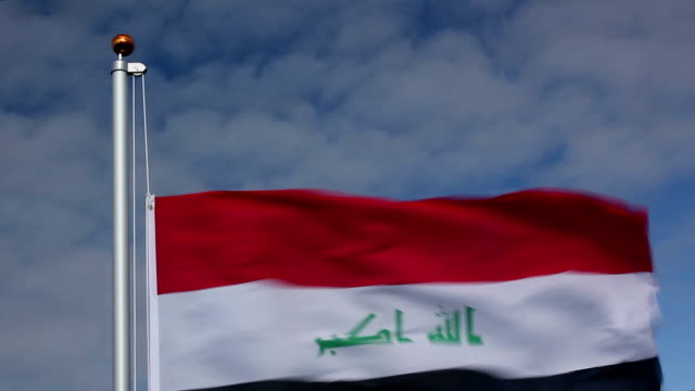 raising the iraq flag - iraqi flag stock videos and b-roll footage