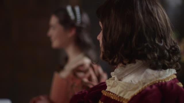 raising toast at medieval feast - medieval era reenactment . - festmahl stock-videos und b-roll-filmmaterial