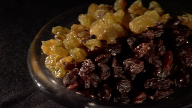 raisins fill a shallow bowl. - natural condition stock videos & royalty-free footage