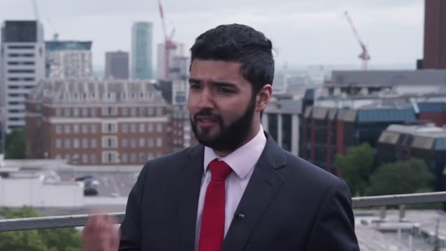 raj kandola of the greater birmingham chambers of commerce talking about how the 5g network will benefit the area - west midlands stock-videos und b-roll-filmmaterial
