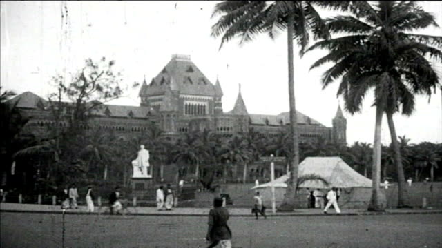 1925 rajabai clock tower and bombay high court building - famous place stock videos & royalty-free footage