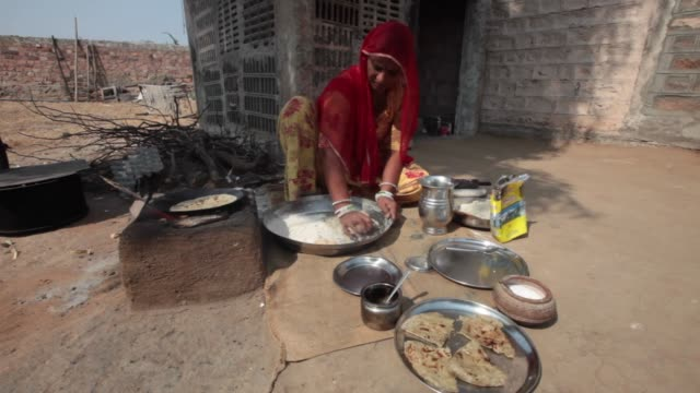 rajasthan india november 4 2014 rajasthani cuisine was influenced by both the warlike lifestyles of its inhabitants and the availability of... - domestic kitchen stock videos & royalty-free footage