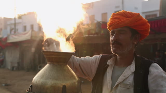 Rajasthani adult man making tea, Pushkar, Rajasthan, India
