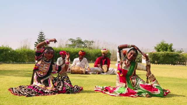 rajasthani folk dancers performing on traditional music, rajasthan, india - tradition stock videos & royalty-free footage