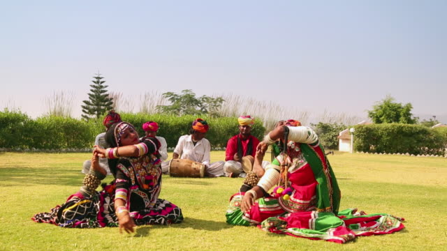 Rajasthani folk dancers performing on traditional music, Rajasthan, India