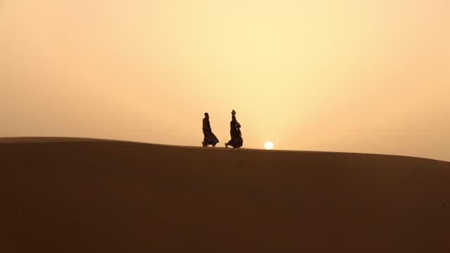 rajasthani people walking on desert, sam desert, jaisalmer, rajasthan, india - balance stock videos & royalty-free footage